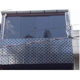 instalação de janela de vidro com grade Moema