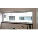 instalação de janela de vidro com madeira Conceição