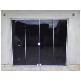 portas de vidro de correr para sala Centro